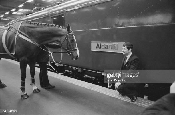 Jockey Bob Champion with his horse Aldaniti at Euston Station in London March 1984