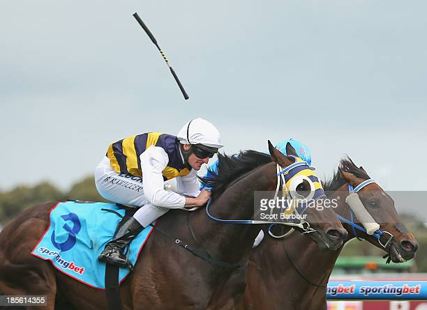 Jockey Brad Rawiller riding Ibicenco loses his whip as he wins race 7 the Sportingbet Geelong Cup during Geelong Cup day at the Geelong Racing Club...