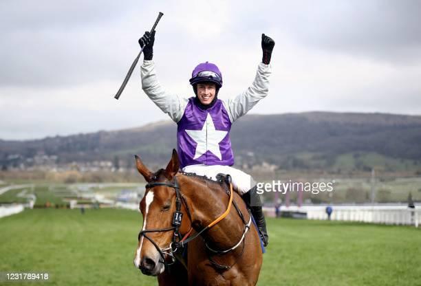 Jockey Bryan Cooper on horse Mrs Milner celebrates after winning the Pertemps Network Final Handicap Hurdle on Day Three of the Cheltenham Festival...