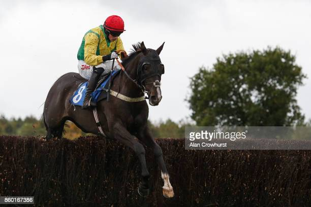 Jockey Bryan Cooper riding Exxaro in the Ann Alan Potts colours at Ludlow racecourse on October 11 2017 in Ludlow England