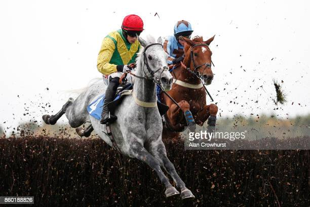 Jockey Bryan Cooper riding Mick Thonic in the Ann Alan Potts colours at Ludlow racecourse on October 11 2017 in Ludlow England