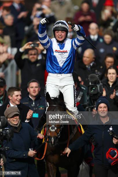 Jockey Bryony Frost celebrates victory as she rides Frodon during the Ryanair Chase race during St Patrick's Thursday at Cheltenham Racecourse on...