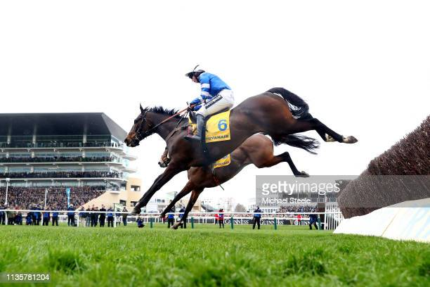 Jockey Bryony Frost on her way to victory as she rides Frodon during the Ryanair Chase race during St Patrick's Thursday at Cheltenham Racecourse on...