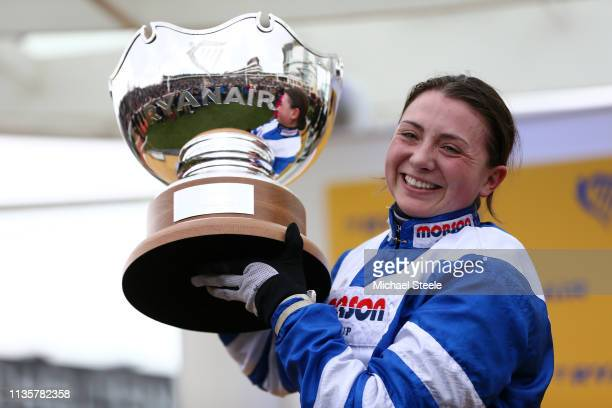 Jockey Bryony Frost poses with the trophy after she rides Frodon to victory during the Ryanair Chase race during St Patrick's Thursday at Cheltenham...