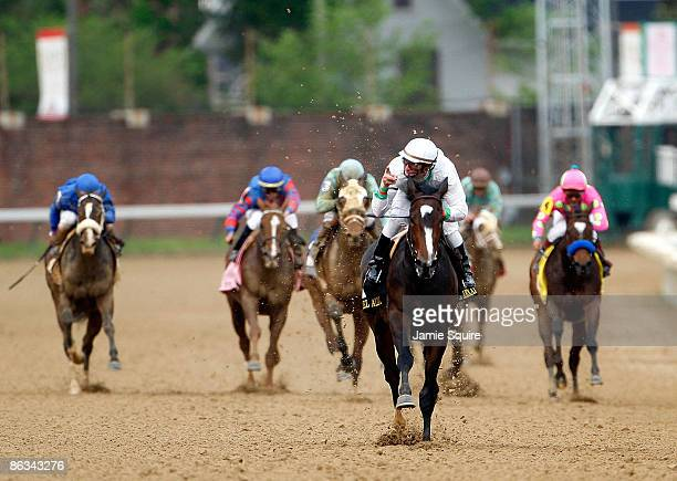 Jockey Calvin Borel points in celebration as he rides Rachel Alexandra to victory during the 135th running of the Kentucky Oaks on May 1 2009 at...