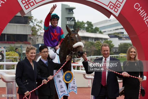 KONG FEBRUARY Jockey Chad Schofield and trainer Tony Millard celebrate after Singapore Sling winning Race 9 The Hong Kong Classic Cup at Sha Tin...