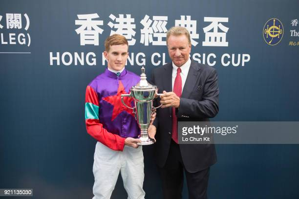 KONG FEBRUARY Jockey Chad Schofield and trainer Tony Millard celebrate after Singapore Sling winning the Race 9 The Hong Kong Classic Cup at Sha Tin...