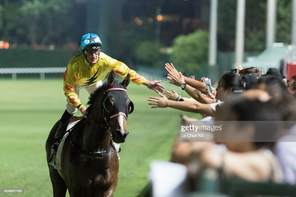 Jockey Chad Schofield riding Outlawed wins the Race 8 Warwick Handicap at Happy Valley Racecourse on May 16, 2018 in Hong Kong, Hong Kong.