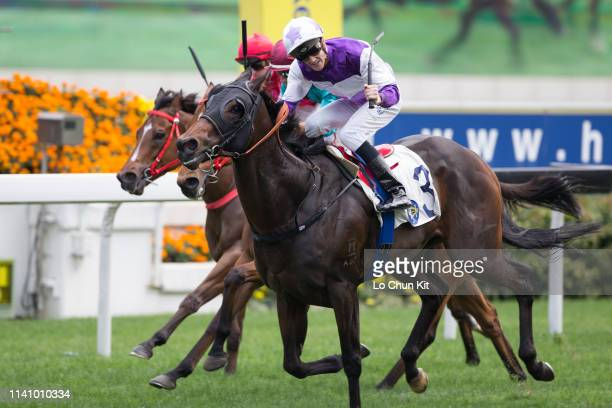 Jockey Chad Schofield riding Rattan wins the Race 3 The Sprint Cup at Sha Tin Racecourse on April 7, 2019 in Hong Kong.
