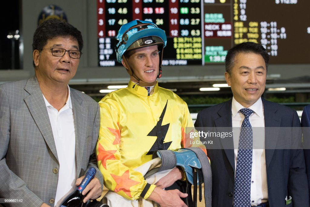 Jockey Chad Schofield, trainer Ricky Yiu Poon-fai and owner celebrate after Outlawed winning the Race 8 Warwick Handicap at Happy Valley Racecourse on May 16, 2018 in Hong Kong, Hong Kong.