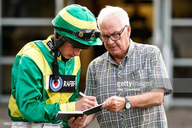 Jockey Charlie Deutsch signs an autograph on his return to race riding at Huntingdon Racecourse on October 16 2018 in Huntingdon United Kingdom