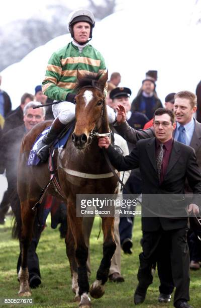 Jockey Charlie Swan is led in on horse Istabraq after wiining the AIG Europe Champion Hurdle at Leopardstown Dublin The Aidan O'Brientrained...