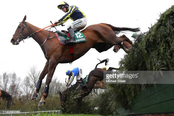 Jockey Charlotte Crane falls from Seefood as Barry O Neill riding Kruzhlinin clears the Becher's Brook fence in the Randox Health Foxhunters' Open...