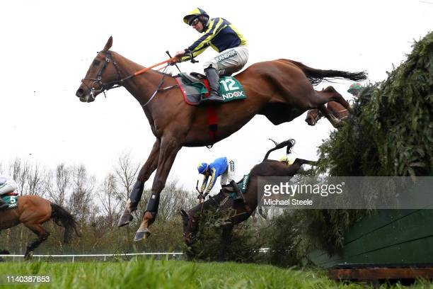 Jockey Charlotte Crane falls of the horse Seefood as Barry O Neill riding Kruzhlinin clears the Becher's Brook fence in the Randox Health Foxhunters'...