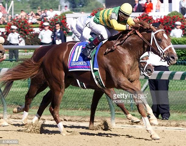 Jockey Chris Antley aboard Kentucky Derby winner Charismatic heads down the stretch to the finish line 01 May 1999 to win the Kentucky Derby at...
