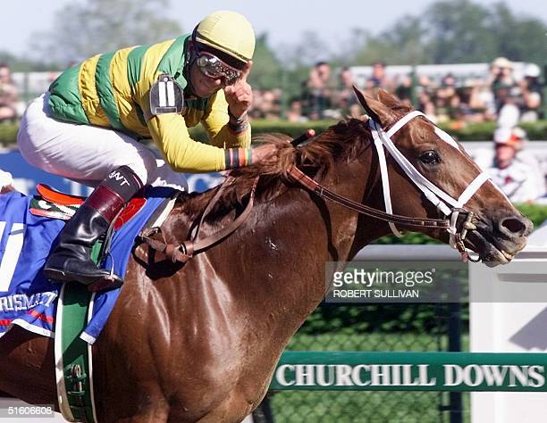 Jockey Chris Antley aboard Kentucky Derby winner Charismatic holds his finger showing number one 01 May 1999 after winning the Kentucky Derby at...