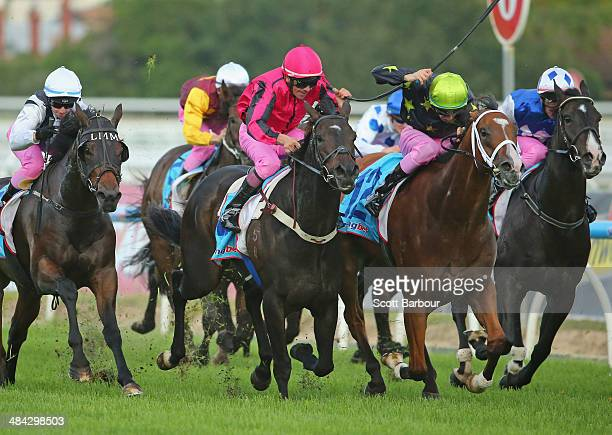 Jockey Chris Johnson riding Natuzzi wins race 6 the 7Eleven Pink Ribbon Cup during 7Eleven Pink Ribbon Cup Day at Caulfield Racecourse on April 12...