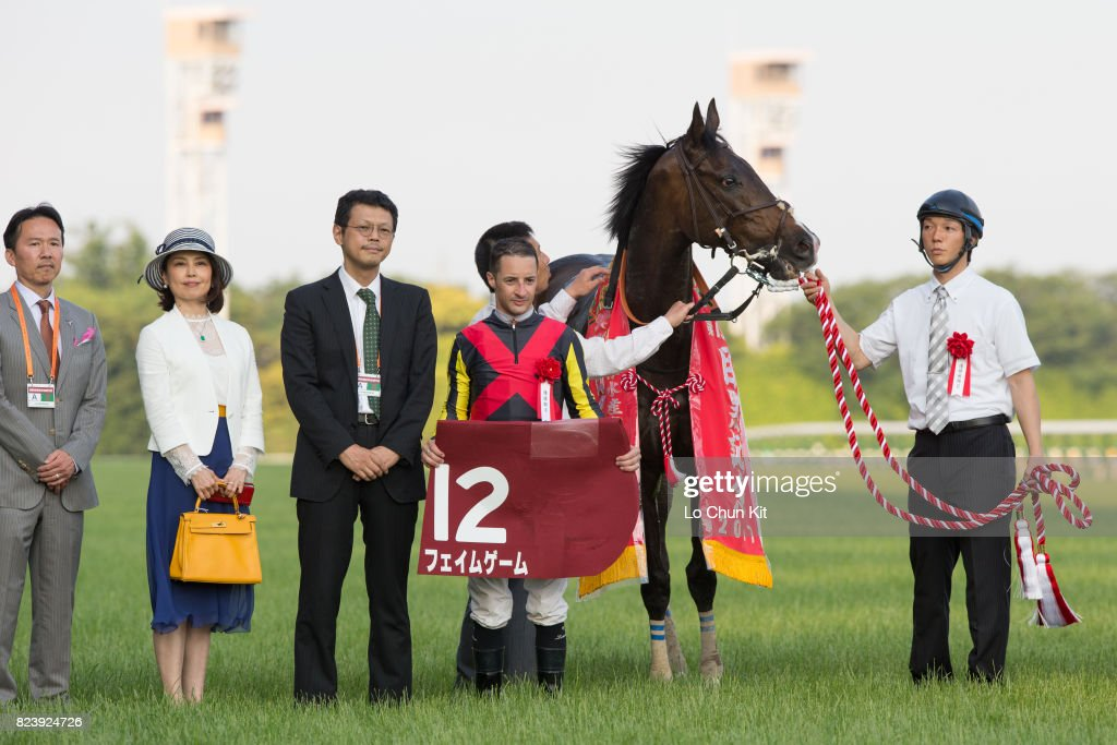 Jockey Christophe Lemaire and owners celebrate after Fame Game winning Meguro Kinen (G2 2500m) at Tokyo Racecourse on May 28, 2017.