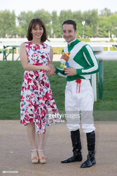 Jockey Christophe Lemaire and Rie Tanaka at the Keeneland Cup presentation ceremony at Sapporo Racecourse on August 27 2017 in Sapporo Hokkaido Japan