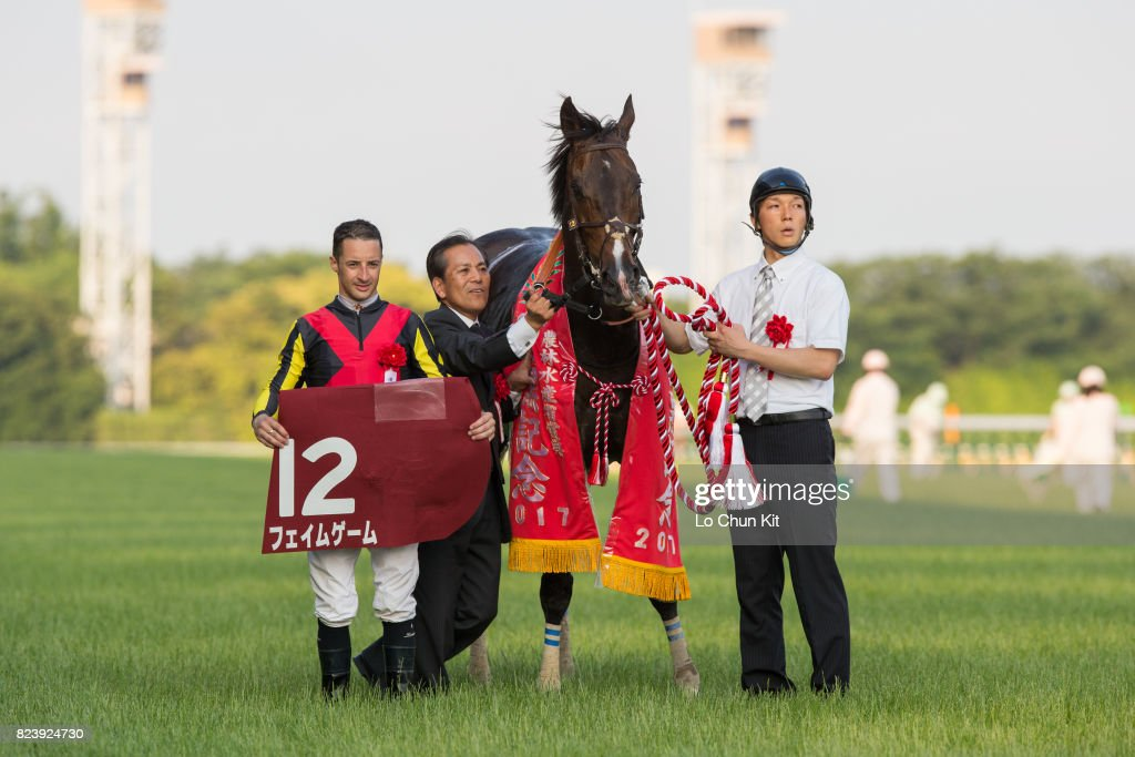 Jockey Christophe Lemaire and trainer Yoshitada Munakata celebrate after Fame Game winning Meguro Kinen (G2 2500m) at Tokyo Racecourse on May 28, 2017.