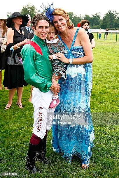 Jockey Christophe Soumillon and wife Sophie Thalmann pose with their daughter after Le Prix de Diane ceremony on June 08 2008 in Chantilly France