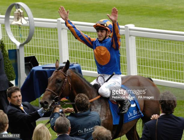 Jockey Christophe Soumillon celebrates after Hurricane Run won The King George VI and Queen Elizabeth Diamond Stakes at Ascot racecourse