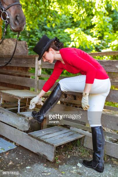 jockey cleaning riding boots - riding boot stock pictures, royalty-free photos & images