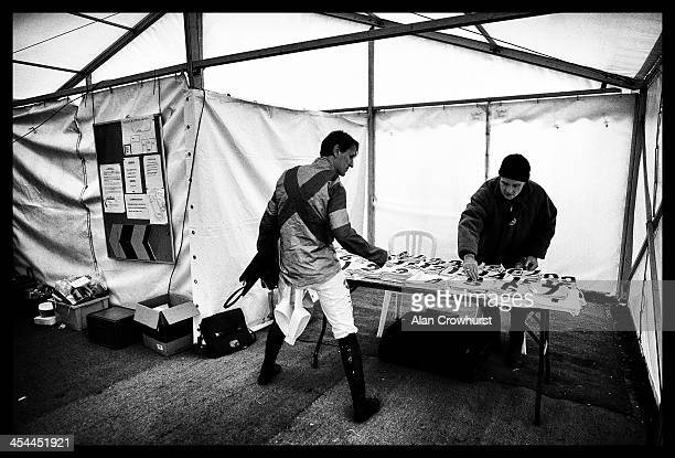 A jockey collects his saddle cloth during the point to point meeting at Barbury Castle racecourse on December 08 2013 in Swindon England