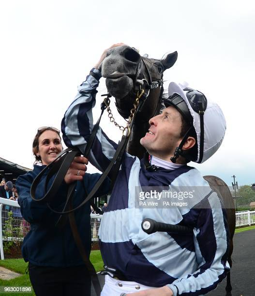 Jockey Colm O'Donoghue and groom Debbie Flavin with Alpha Centauri after their win Tattersalls 1000 Guineas during day two of the 2018 Tattersalls...