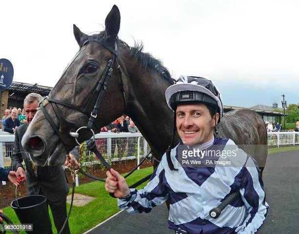 Jockey Colm O'Donoghue with Alpha Centauri after their win Tattersalls 1000 Guineas during day two of the 2018 Tattersalls Irish Guineas Festival at...