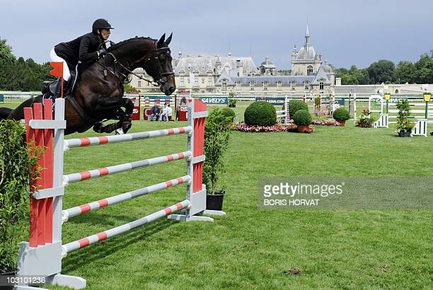 Jockey competes in the International Chantilly Show Jumping on July 23, 2010 in Chantilly, near Paris. At background is the Chantilly castle . AFP...