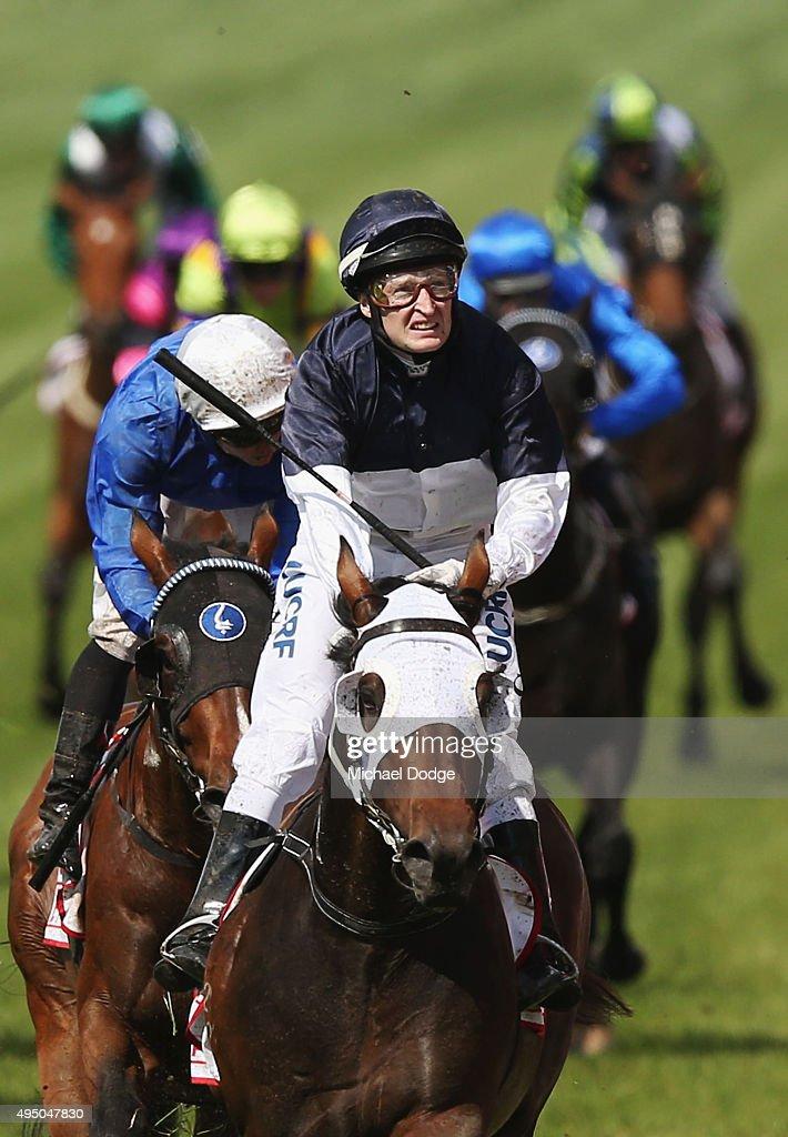 Jockey Craig Newitt riding Tarzino wins race 7 The AAMI Victoria Derby on Derby Day at Flemington Racecourse on October 31, 2015 in Melbourne, Australia.
