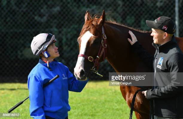 Jockey Craig Williams and strapper Matt Scown pose with Admire Deus from Japan after a trackwork session at Werribee Racecourse on October 3 2017 in...