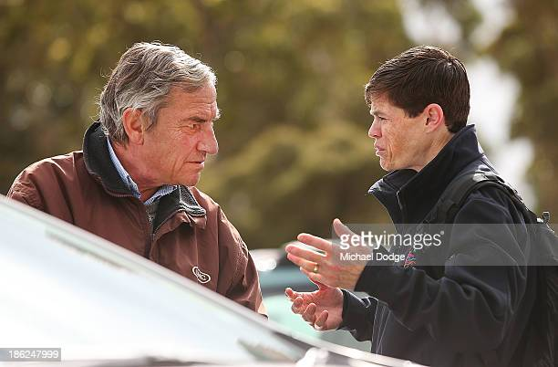 Jockey Craig Williams gestures to Mount Athos trainer Luca Cumani after the horse galloped during trackwork at Werribee Racecourse on October 30 2013...