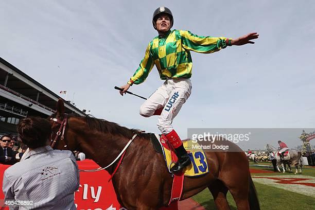 Jockey Craig Williams jumps off Scarlett Billows after winning race 10 the Hong Kong Jockey Club Stks on Melbourne Cup Day at Flemington Racecourse...