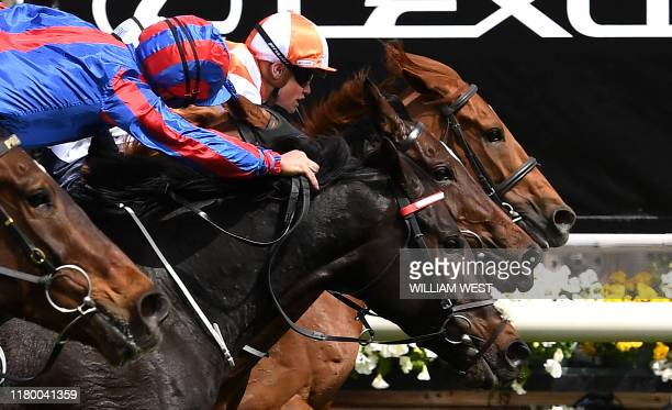 Jockey Craig Williams onboard Vow and Declare wins the Melbourne Cup horse race in Melbourne on November 5, 2019. / -- IMAGE RESTRICTED TO EDITORIAL...