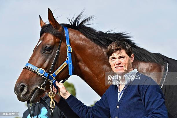 Jockey Craig Williams poses with 2014 Emirates Melbourne Cup winner Protectionist at Caulfield Racecourse on March 13 2015 in Melbourne Australia...