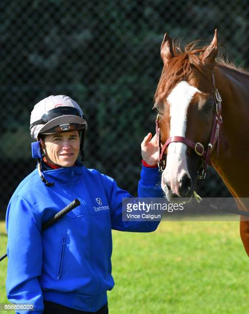 Jockey Craig Williams poses with Admire Deus from Japan after a trackwork session at Werribee Racecourse on October 3 2017 in Melbourne Australia