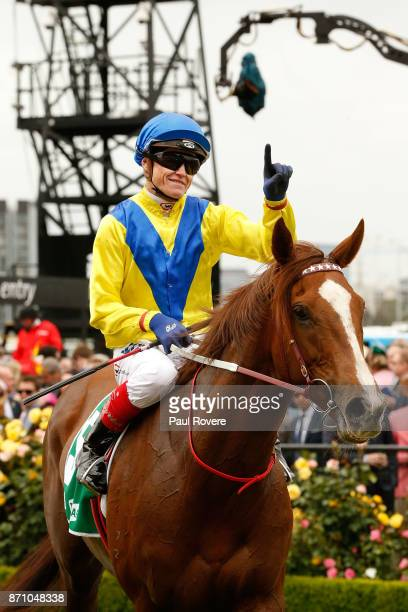 Jockey Craig Williams returns to scale on Tahanee after winning race 2 the TABcomau Trophy during Melbourne Cup Day at Flemington Racecourse on...