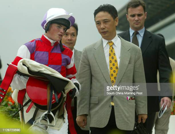 Jockey Craig Williams returns to scale with horse trainer Andy Leung after mounting Cheerful Fortune to win the Race 7 at Sha Tin Racecourse 18 May...
