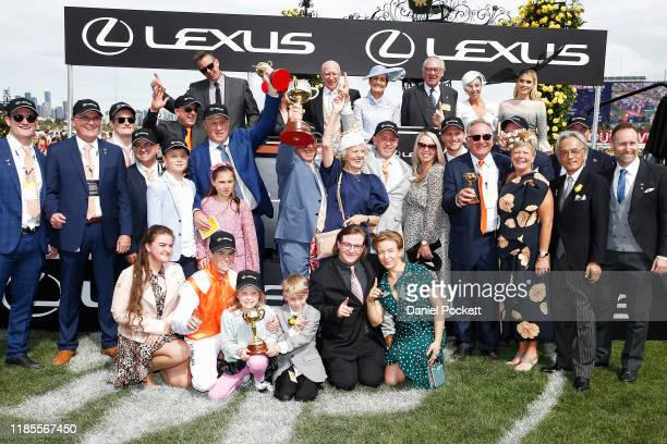 Jockey Craig Williams trainer Danny O'Brien and connections hold the trophies after winning with Vow And Declare during 2019 Melbourne Cup Day at...