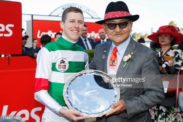 Jockey Damian Lane and trainer Yoshito Yahagi celebrate after winning race 9 the Ladbrokes Cox Plate during Cox Plate Day at Mooney Valley Racecourse...