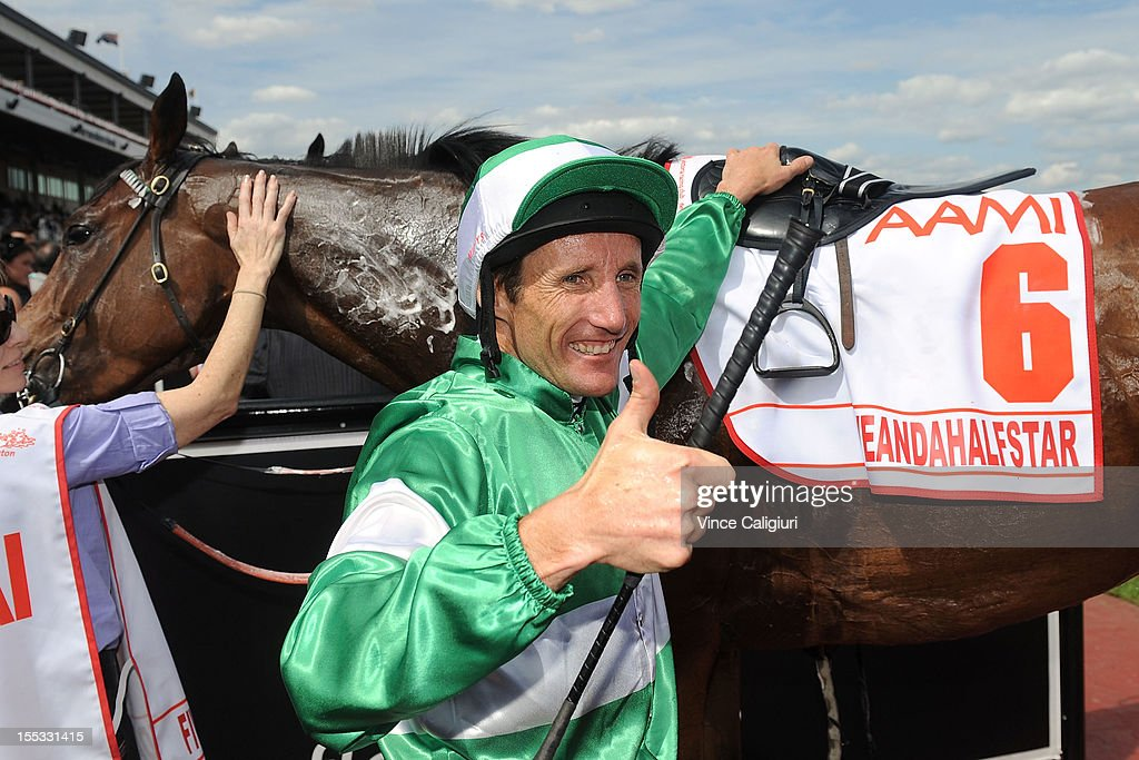 Jockey Damien Oliver celebrates winning the AAMI Victoria Derby riding Fiveandahalfstar during Victorian Derby Day at Flemington Racecourse on November 3, 2012 in Melbourne, Australia.