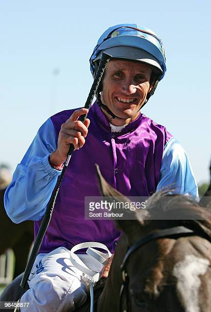 Jockey Damien Oliver gestures after riding Velocitea to win the Hyderabad Race Club Stakes during the CF Orr Stakes Day meeting at Caulfield...
