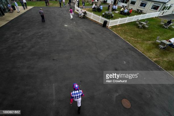Jockey Dane ONeill makes his way to the parade ring at Bath Racecourse on July 17 2018 in Bath United Kingdom