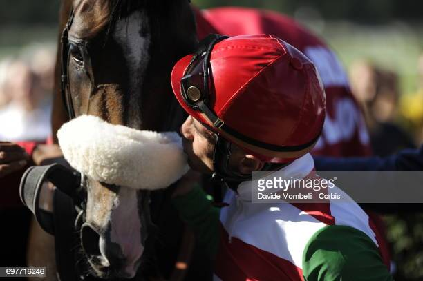 Jockey Dario Vargiu celebrates after riding Full Drago to victory in the Grand Prix in Milan at the San Siro Racecourse on June 18 2017 in Milan Italy