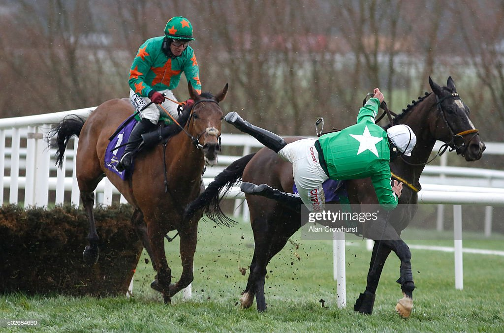 Jockey Davy Russell is unseated from Showem Silver in The At The Races Maiden Hurdle at Leopardstown racecourse on December 28, 2015 in Dublin, Ireland.