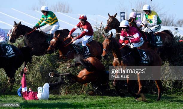 Jockey Davy Russell on eventual winner Tiger Roll takes evasive action after Alpha Des Obeaux unseats jockey Rachael Blackmore at The Chair during...