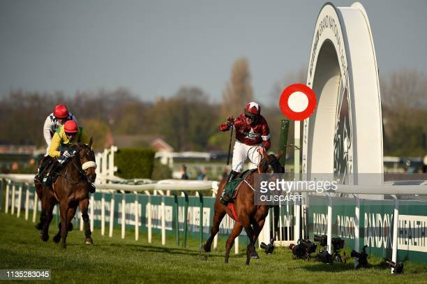 Jockey Davy Russell on Tiger Roll competes to win ahead of Magic Of Light riden by jockey Paddy Kennedy and Rathvinden riden by jockey Ruby Walsh to...