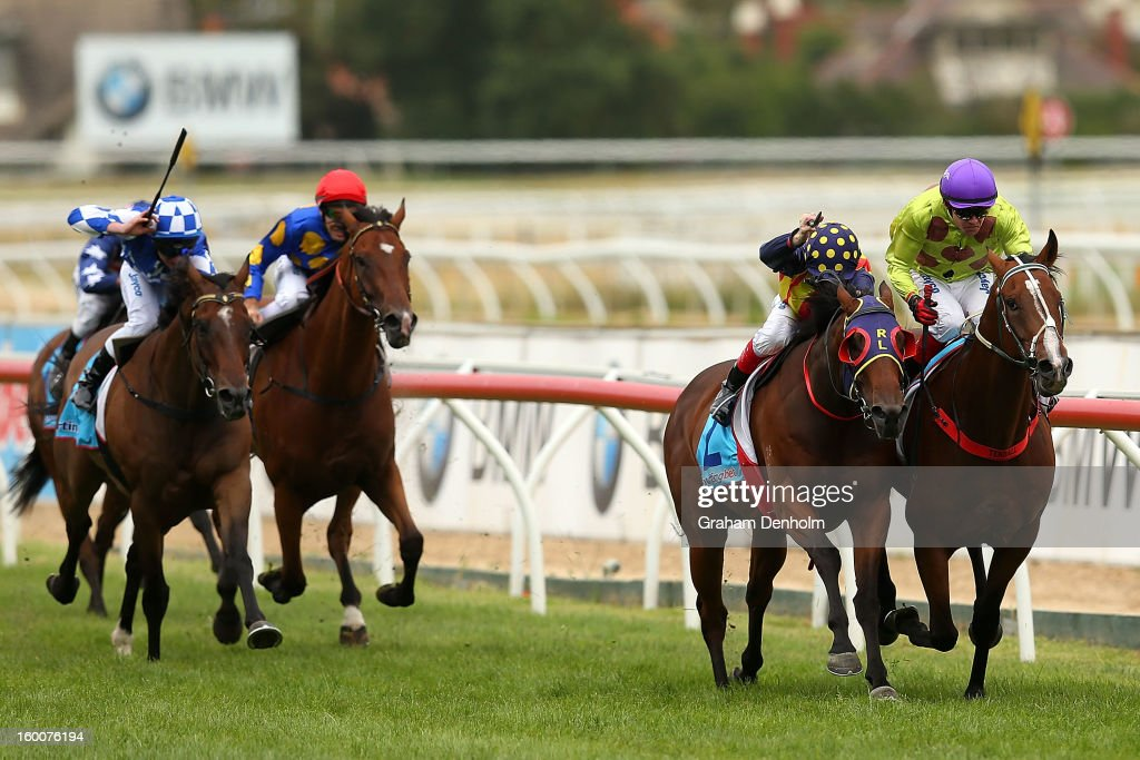 Jockey Dean Yendall (R) riding Le Remas wins race six the Swettenham Stud John Dillon Stakes during Australia Day Races at Caulfield Racecourse on January 26, 2013 in Melbourne, Australia.